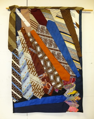 "wall hanging made from client's ""ugly"" tie collection"